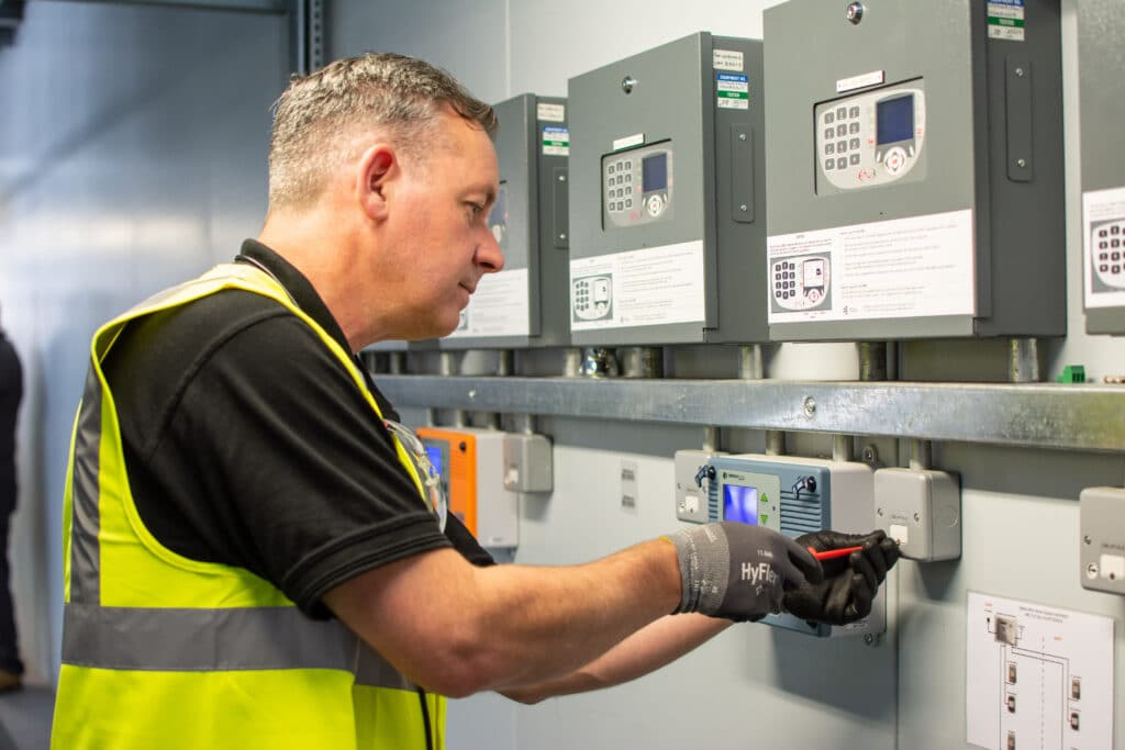 Engineer testing a fuse